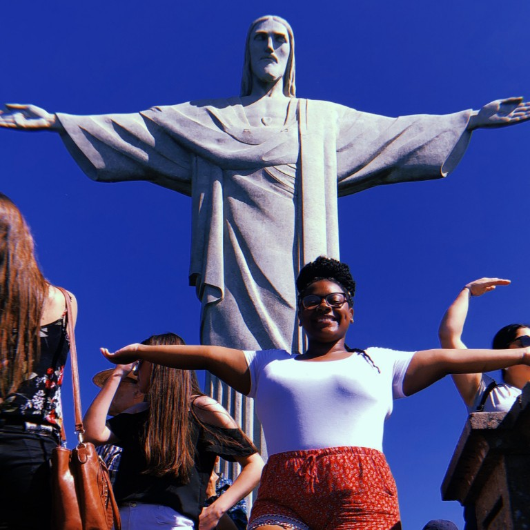 HIEP recipient photo from travel in South America - Chyna Johnson poses before the statue of christ the redeemer in Rio de Janiero