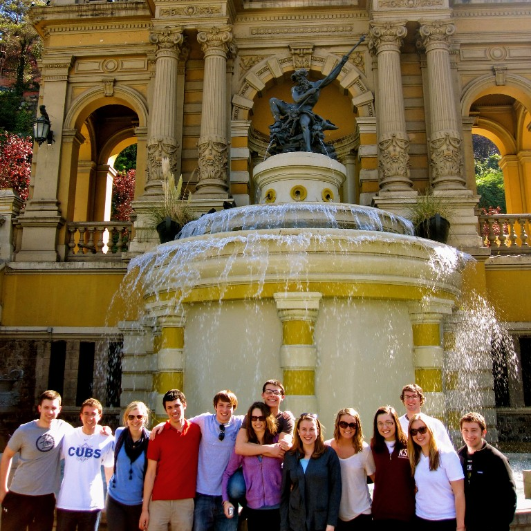 HIEP recipient photo from travel in the Americas - Kyle Straub and friends pose in front of a historic building in Chile