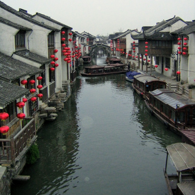 HIEP recipient photo from travel in Asia and the Middle East - photo of a canal lined with buildings in China