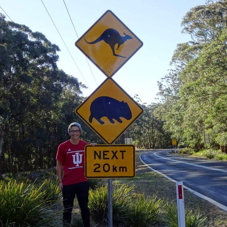 HIEP recipients in Australia - Jacob Nixon posing with a kangaroo crossing sign in Australia