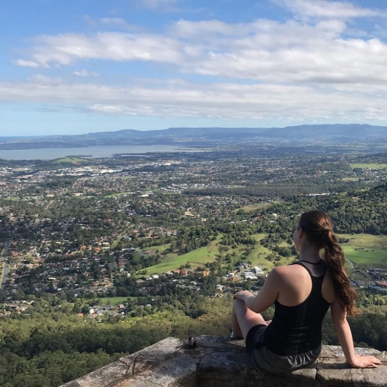 HIEP recipients in Australia - Sydney Kawalec sits on a mountain overlooking Wollongong Australia
