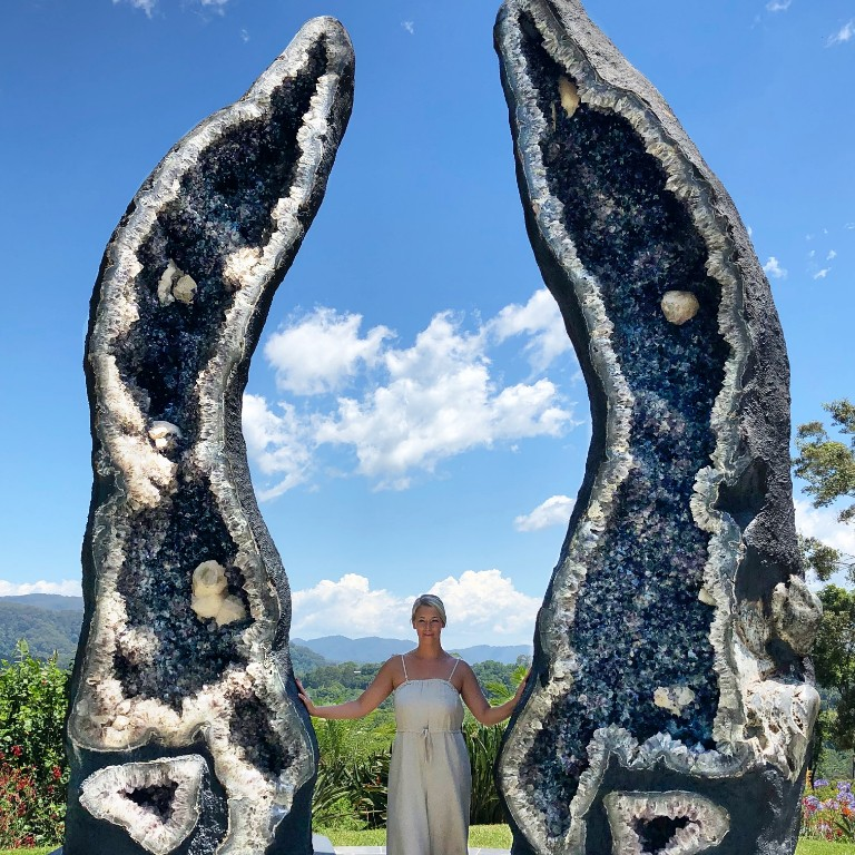 HIEP recipients in Australia - Maria Pairitz poses for a picture between two halves of a giant geode in Byronbay Australia