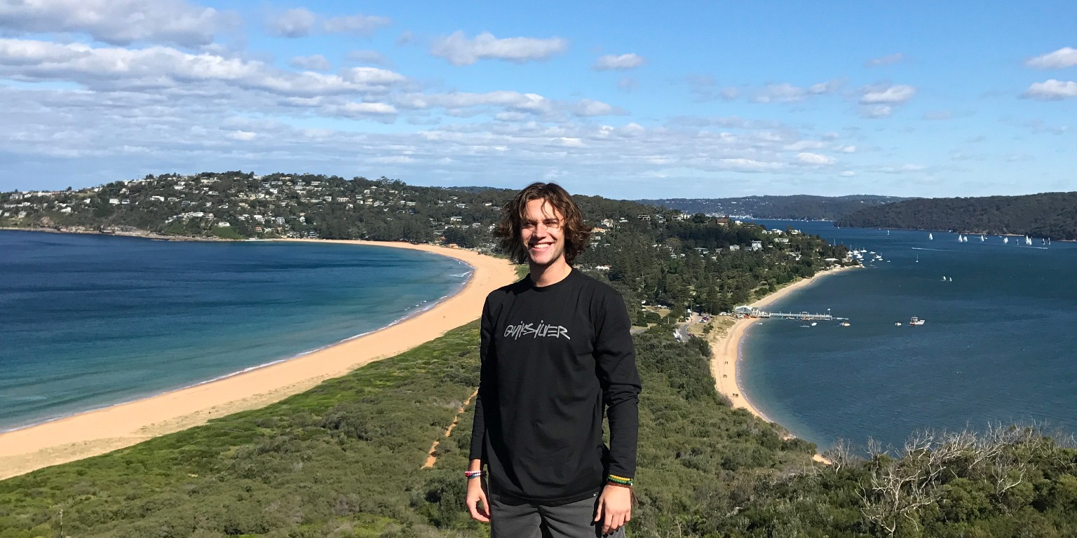 HIEP recipients in Australia - Brandon Stesiak stands on the narrowest part of a large peninsula jutting out into the ocean