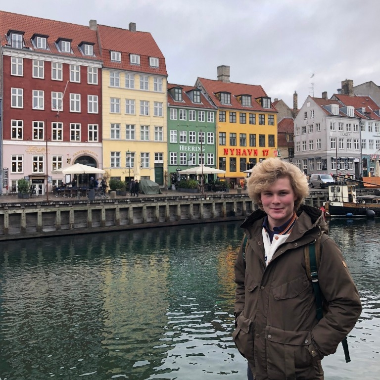 HIEP recipient photo from travel in Europe - student visits an ocean inlet in Copenhagen with brightly colored buildings across the waterway