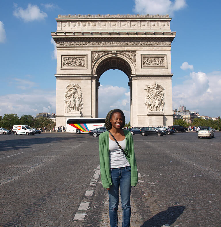 HIEP recipient photo from travel in Europe - Kristen Bard in Paris standing in front of the Arc du Triomphe