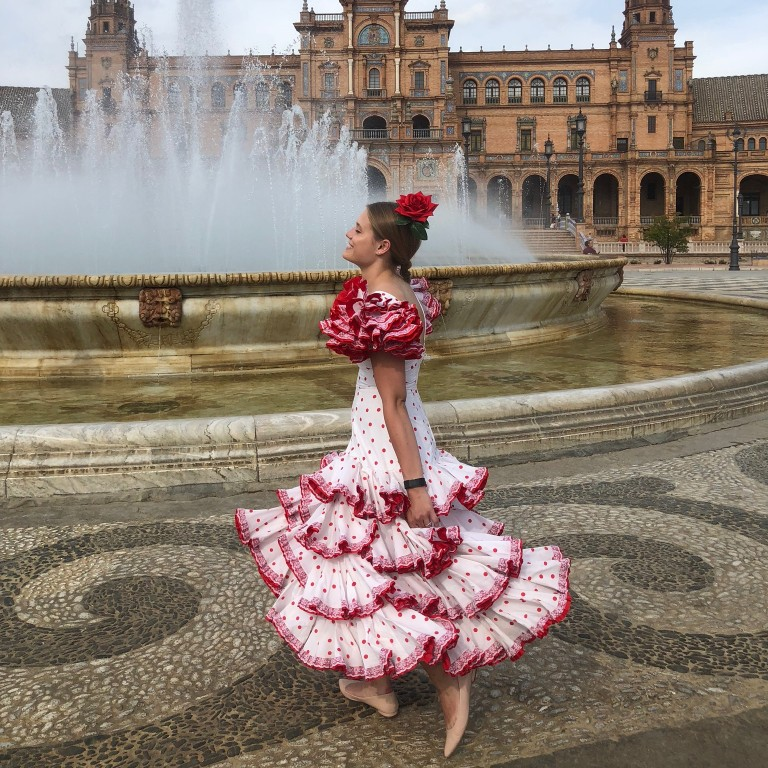 HIEP recipients in Spain - Bailey Foster in a traditional Spanish dress in front of a fountain in Seville