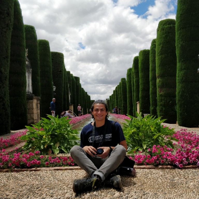 HIEP recipients in Spain - Jeremy Ambrosio sits in an elaborate garden in Seville